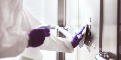 worker sanitizing commercial property